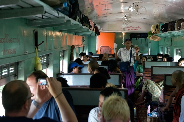 Man selling medicin in the first class carriage in the train to Hsipaw