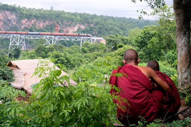 Monks wieving train crawling over Gokhteik Viaduct