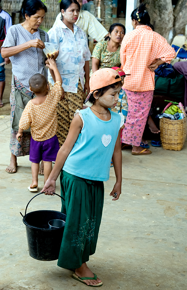 Boy selling water at a railway startion