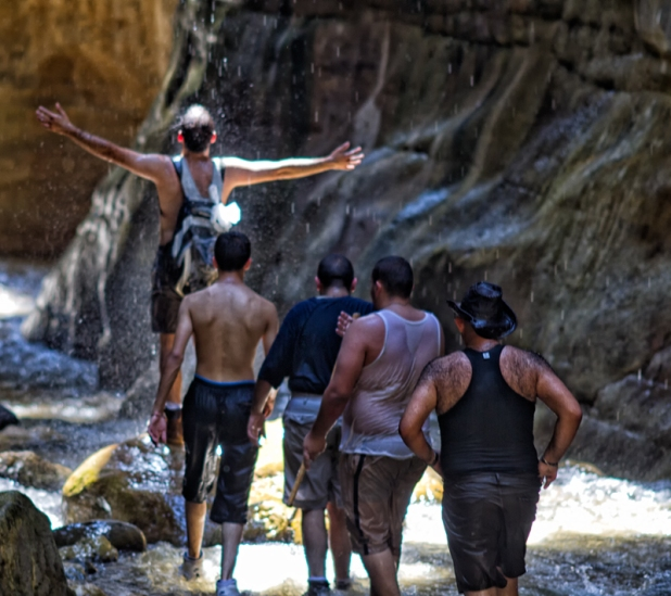 Taking a shower in Wadi Ibn Hammad