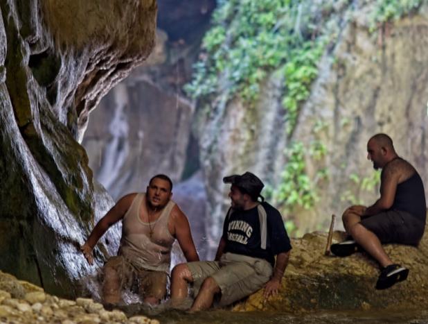 Climbing a waterfall in Wadi Ibn Hammad