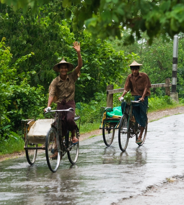 Bicycle Trishaw men in Mrauk-U during rainy season
