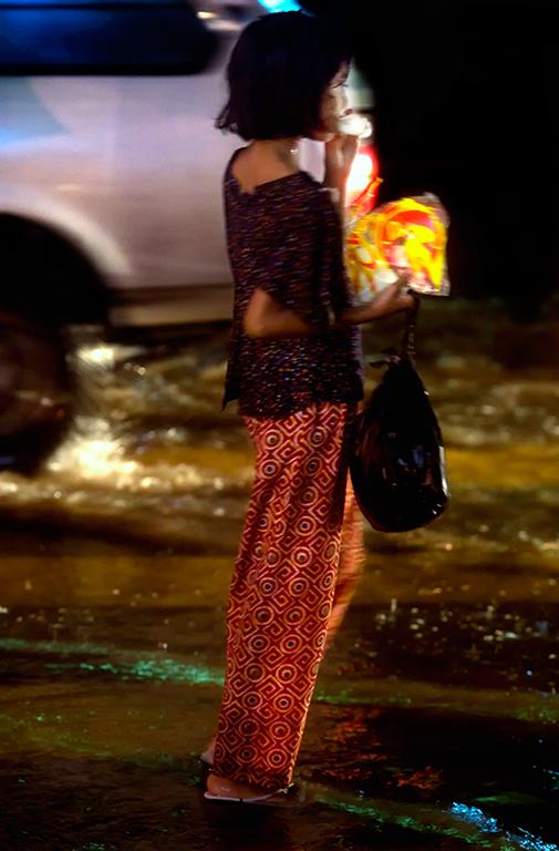 Girl in monsoon rains Yangon