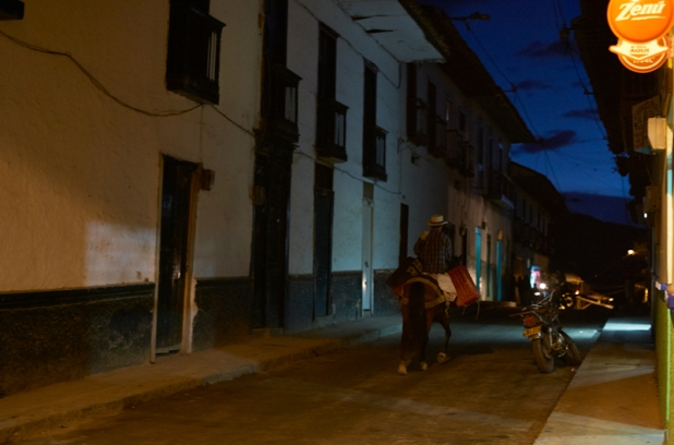 Farmer riding home during the night in Salamina