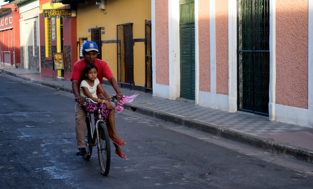 Man and girl on a bicycle