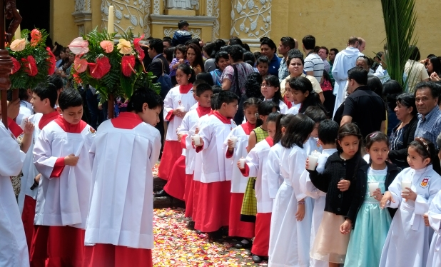 Children at the cathedral before the priest comes out